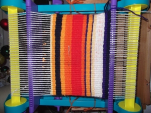 Visual of the weave in progress on the child's loom